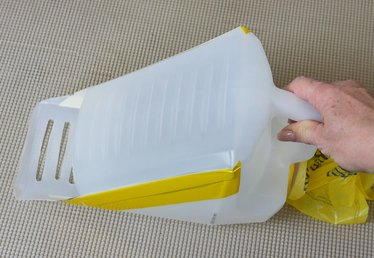 How to Turn a Kitty Litter Container Into a Kitty Litter Scoop