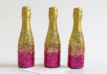 How to Decorate Mini-Champagne Bottles With Glitter