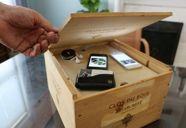 Want to Organize and Hide Your Electronics? Create a Charging System Out of a Wine Crate