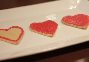 Decorating a Sugar Cookie With Royal Icing & Colored Sugar on Valentine's Day