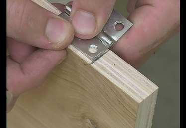 How to Install Door Hinges on a Bookshelf