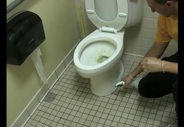 Removing Stains Around the Base of a Toilet