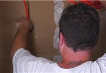How to Run Electrical Wires Through a Wall
