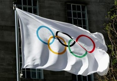 What Do the Five Olympic Signs on the Flag Symbolize?