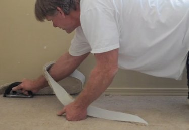 How to Edge Trim Carpet Along a Wall