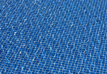 How to Use Sodium Carbonate to Raise the PH Level in Swimming Pools