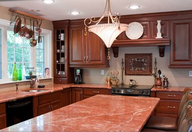 The Best Color Granite With Cherry Cabinets and Black Wooden Floors