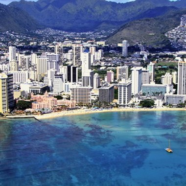 Waikiki Beach attracts visitors from around the globe with its fun nightlife, posh shopping and great cuisine.