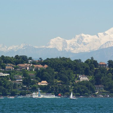 The snow-covered Alps are a stunning backdrop to Lake Geneva.