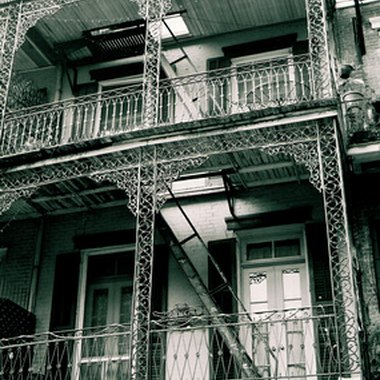 Wrought iron balconies are a defining feature in New Orleans architecture.