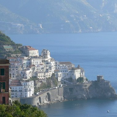 White houses cluster along the Amalfi coastline.