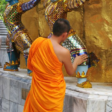 Saffron-robed monks are a common sight at Bangkok's Grand Palace.