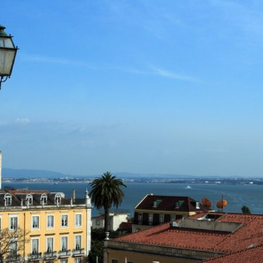 Hilltop hotels in Lisbon offer views of rooftops and the Tagus.