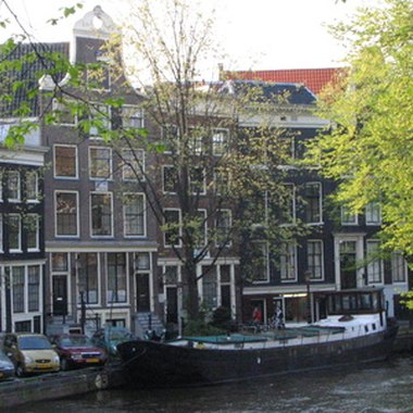 Traditional houses and canals characterize Amsterdam's city center.