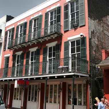 Brick facades and wrought-iron balconies characterize Bourbon Street architecture