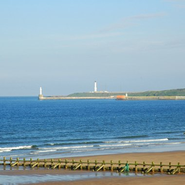 Lighthouses and levies on the North Sea coast near Aberdeen, Scotland