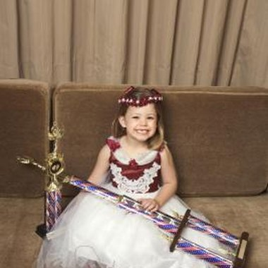 Girls may win trophies and self-confidence at beauty pageants.