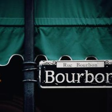 The French Quarter's Bourbon Street is a 10-minute cab ride from Erato Street.