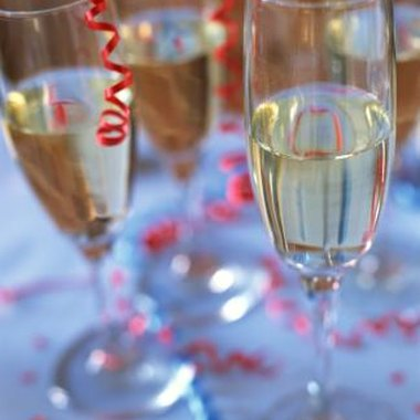 Champagne and confetti are traditional images for New Year's invitations.