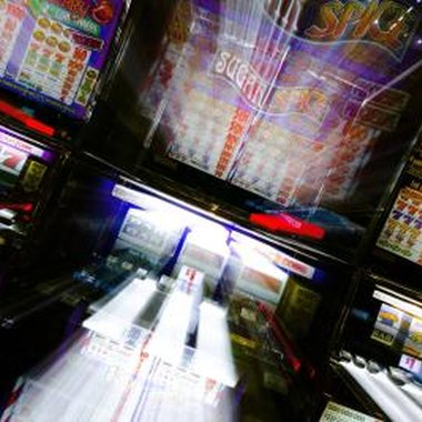 State law requires licensing fees for slot machines.