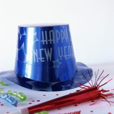 Buy party hats and noisemakers to celebrate New Year's with your children.