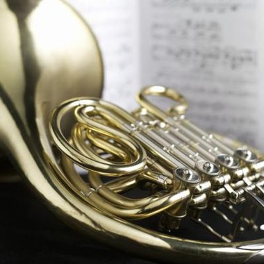 The double French horn has four valves and eight slides.