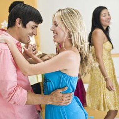 Inviting another couple can convince your boyfriend to attend a dance.