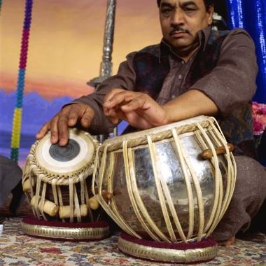 Musicians play tabla drums to accompany instrumental and vocal performances.