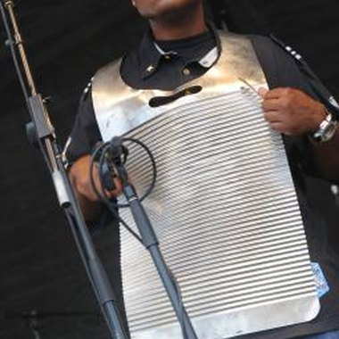 Zydeco musician playing the rub board