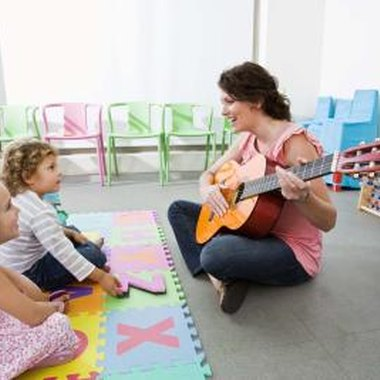 Singing the same song consistently with your child helps her memorize the lyrics.