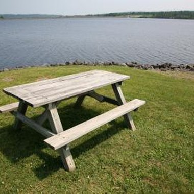 Classic picnic tables have a table and two attached benches.