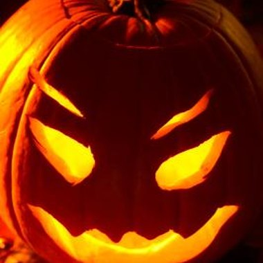 Play pumpkin carving games to see who can come up with the scariest jack-o-lantern.