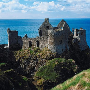 Dunluce Castle is built on a 100-ft. cliff with a sea cave beneath.