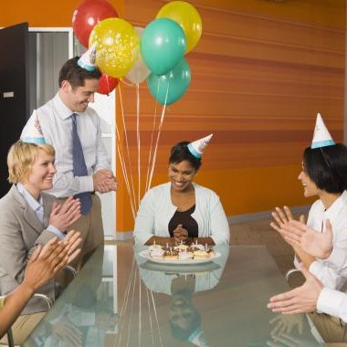 Insist that everyone wear a birthday hat for your co-worker's 50th birthday celebration.