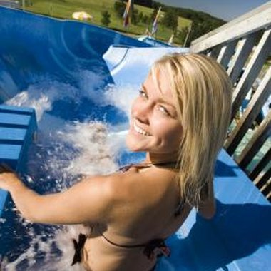 Towering water slides found in water parks bring fun for the whole family.