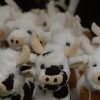 Stuffed cows can help children recreate the nursery rhyme.