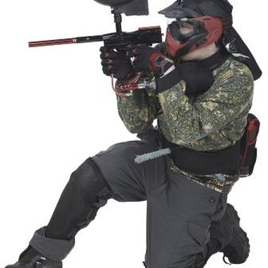 Paintball players wear protective gear, such as masks and heavy clothing.