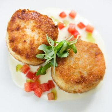Savory crab cakes are pan-seared, fried or grilled.