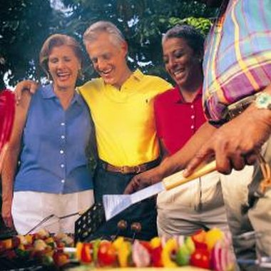 Most people enjoy themselves at a barbecue.