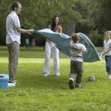 Families can picnic in the park while children play on the playground.