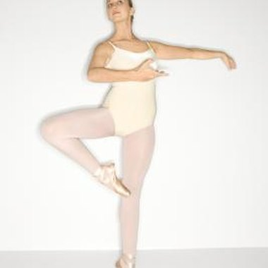 In the passé, the dancer raises the toes above the knee of the supporting leg.