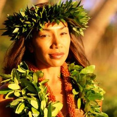 The green leis on this woman's head and around her neck are made of maile.