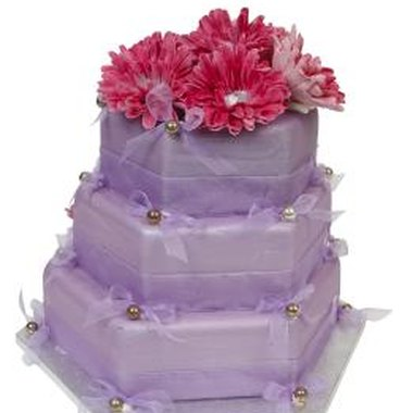 Purple icing turns a basic cake into a pretty party centerpiece.