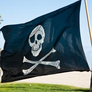 Add a real or poster board Jolly Roger flag to the cardboard pirate ship.