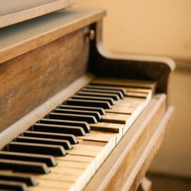 Consult a piano technician before restringing an old piano.