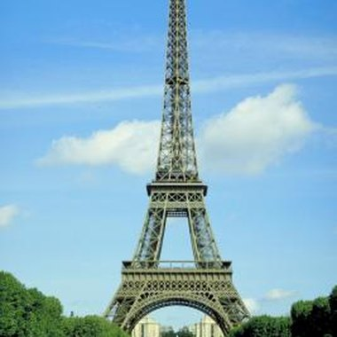 Paint the Eiffel Tower by using a photo or postcard as a guide.