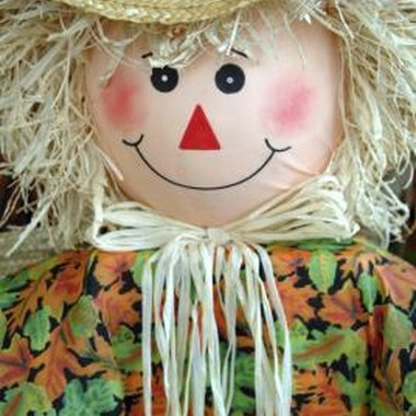 Dress up a scarecrow with a decorative raffia bow.
