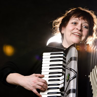 The left and right hands perform different functions on the accordion.