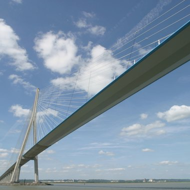 Cable-stayed bridges are similar to suspension bridges.