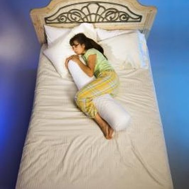 A body pillow supports your joints while you sleep on your side.